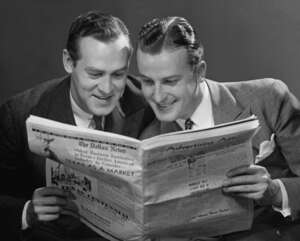 Men reading a newspaper