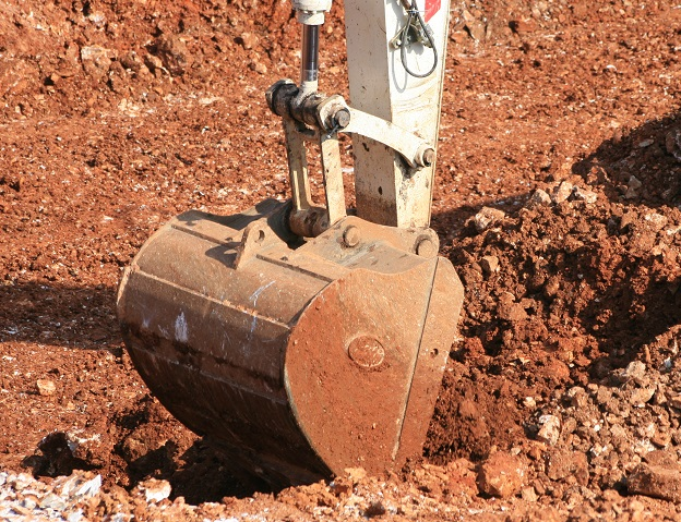 excavator-digging-earth-brown