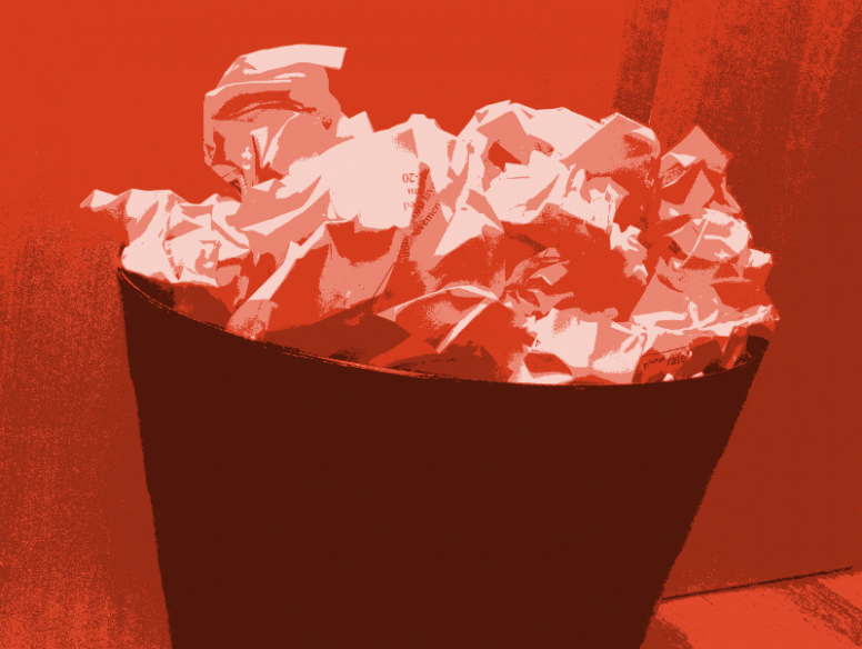 small-red-trash-can-with-papers